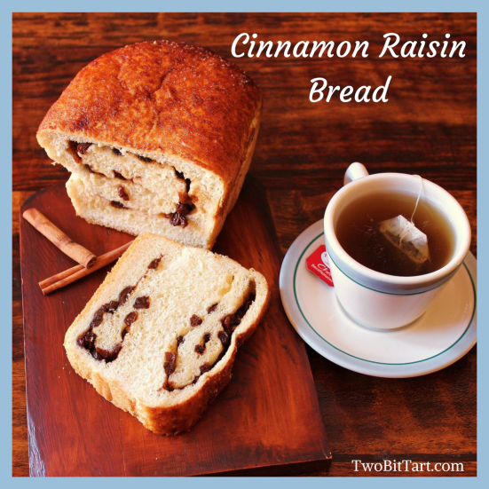 Sliced homemade cinnamon raisin bread and a cup of tea