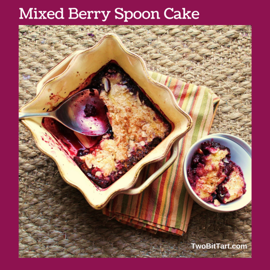 Berry Almond Spoon Cake in a scalloped baking dish