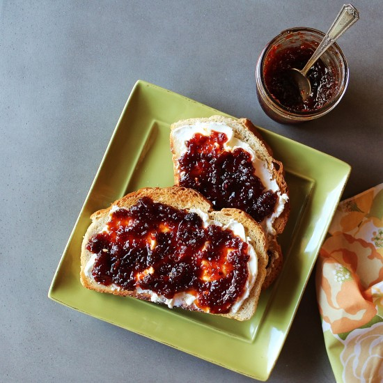 Two pieces of toast slathered with cream cheese and chili pepper honey jam