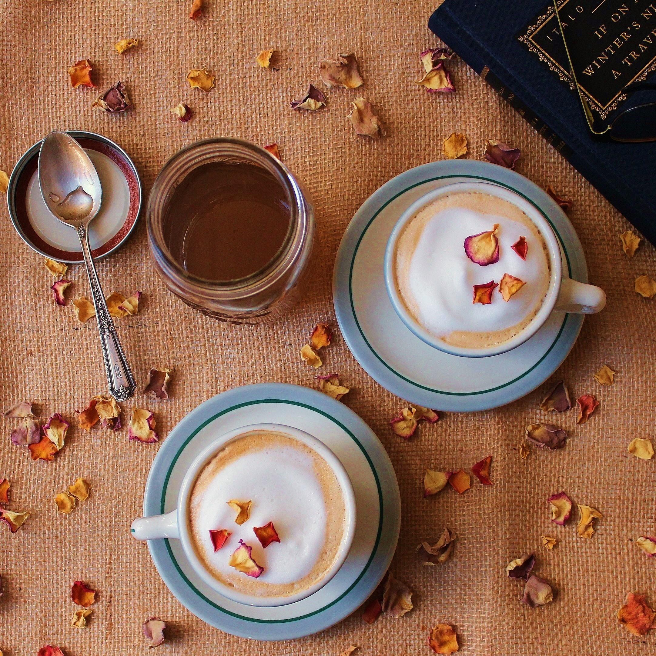 Cardamom Rose latte garnished with rose petals