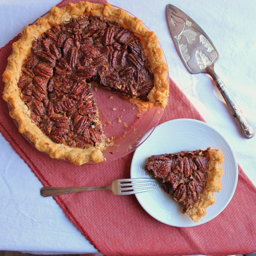 a slice of chocolate pecan pie