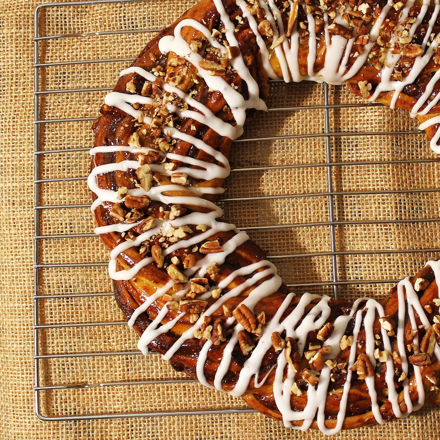 A ring of pumpkin spice couronne glazed with icing