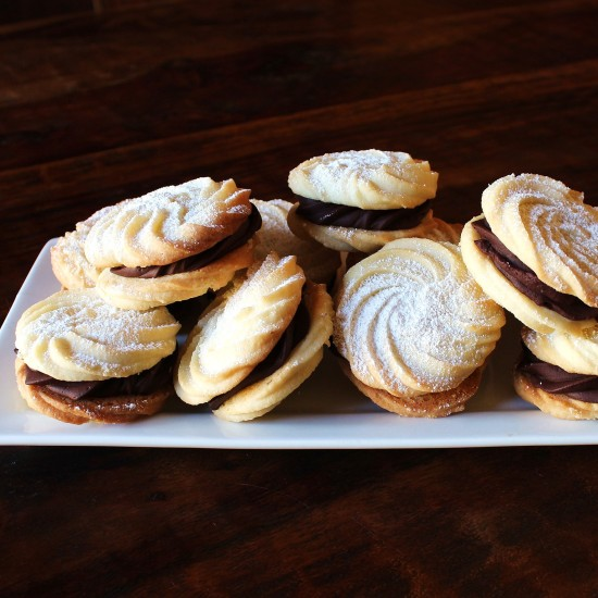 A plate of sugar-dusted Viennese Whirls