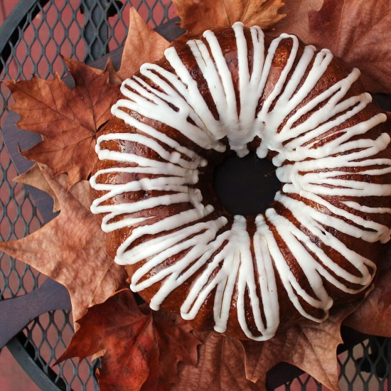 Autumn Apple cake on a bed of fallen leaves