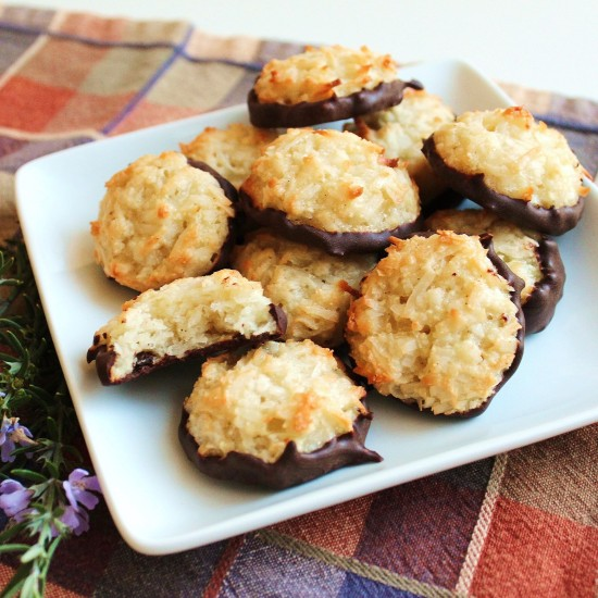 A plate of chocolate-dipped coconut macaroons