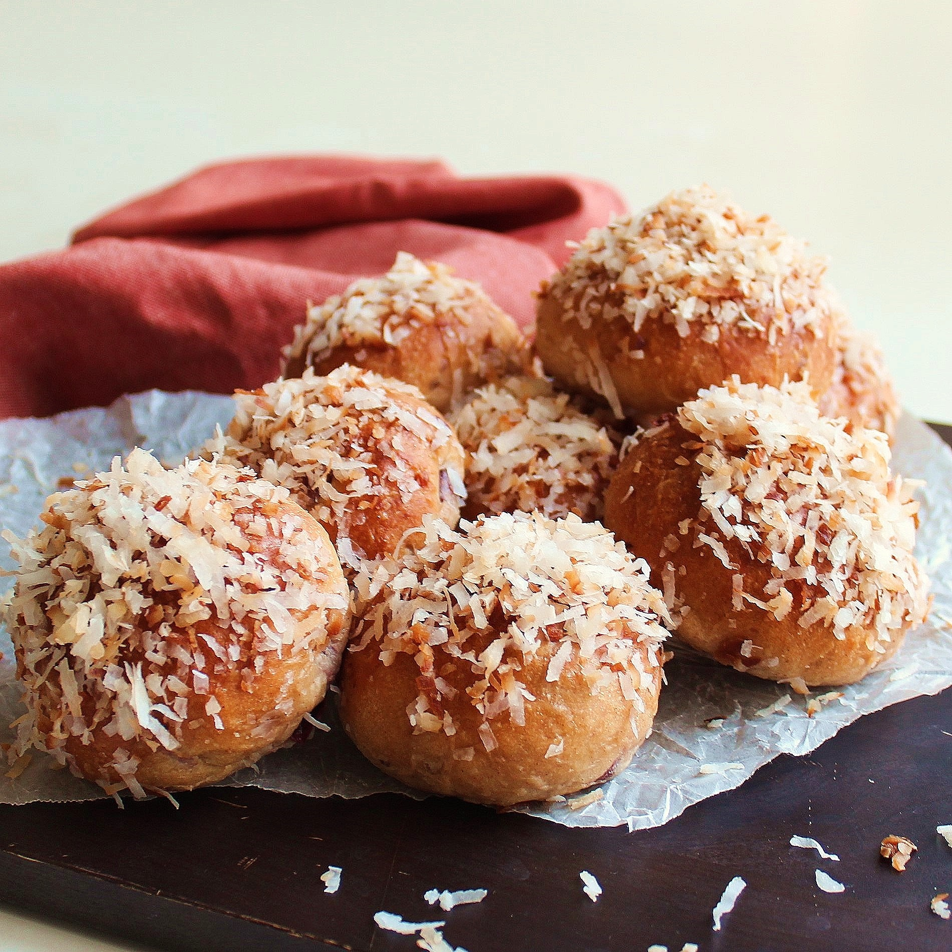 A pile of Coconut Cherry Breakfast Buns sprinkled with toasted coconut