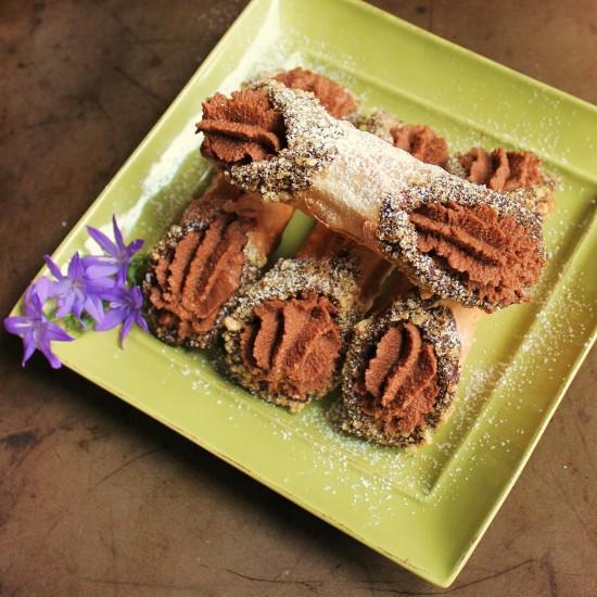 A plate of 4 Hazelnut Mocha Cannoli