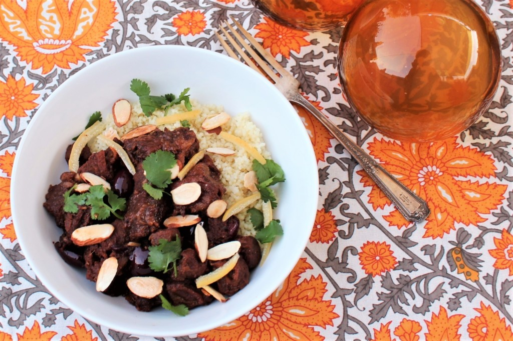 Lamb Tagine over couscous in a white bowl