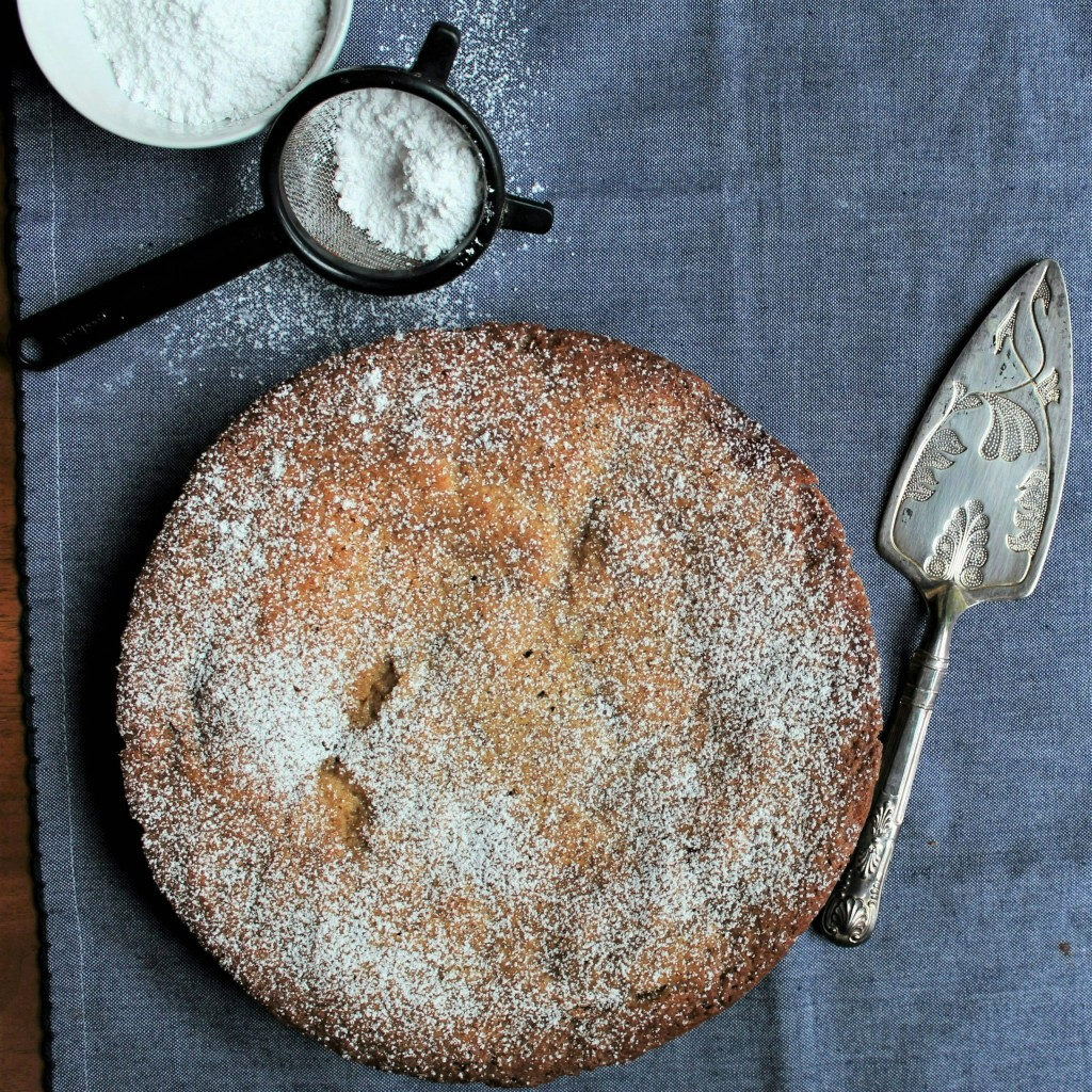 Swedish Apple Pie on a blue background with pie cutter