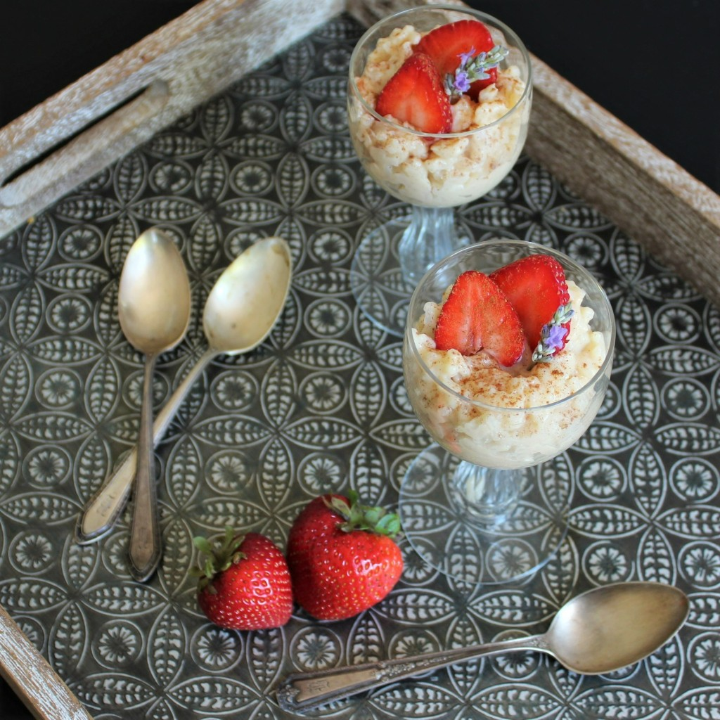 Two servings of rice pudding with stawberries
